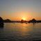 Sunset on the cheap Ha Long Bay cruise, Vietnam
