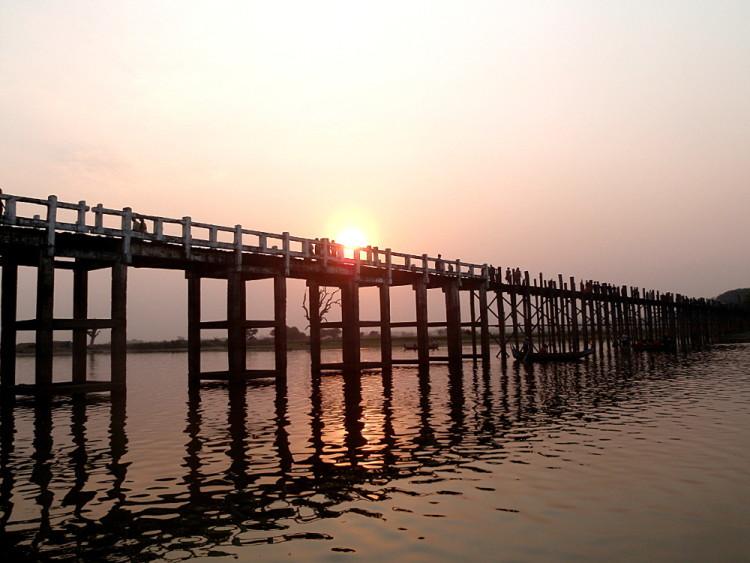 The longest teak bridge in the world at sunset in Amarapura, one of the old capitals in Mandalay, Myanmar