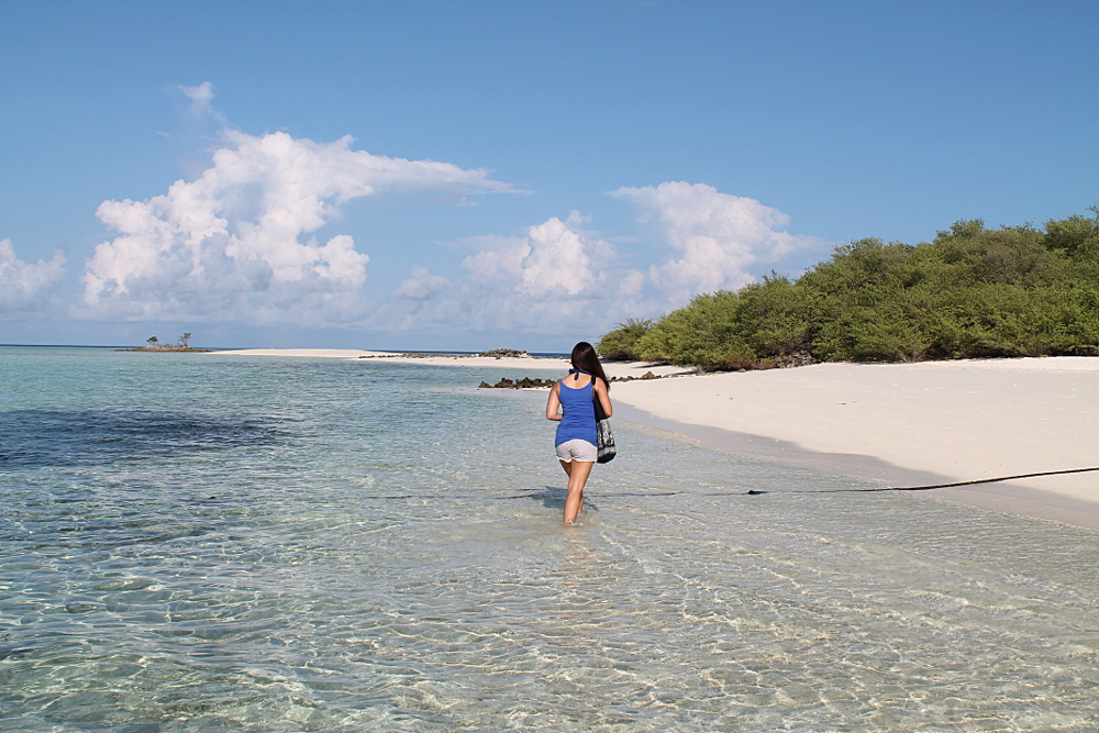 Walking through the water on Asdu Sun Island, the Maldives