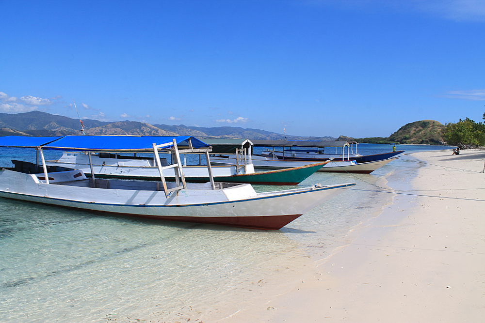 Boats on the beach after snorkelling in the 17 Islands Marine Park in Riung, Flores, Indonesia