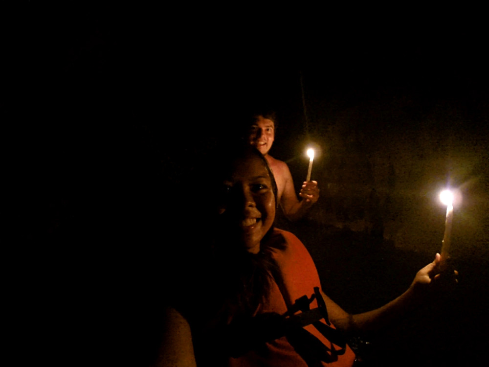 Kamba caves by candlelight at Semuc Champey, Guatemala