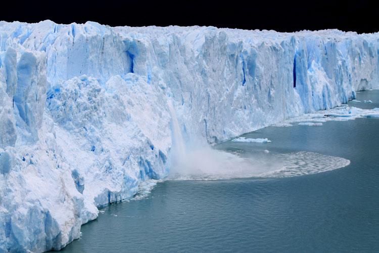 Ice falling off Perito Moreno Glacier, Patagonia, Argentina
