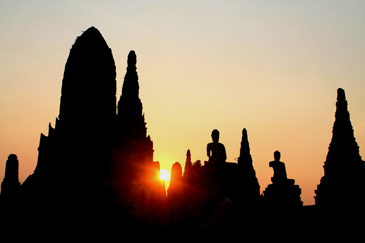 Cycling to the ruins in Ayutthaya, Thailand -- temple sunset