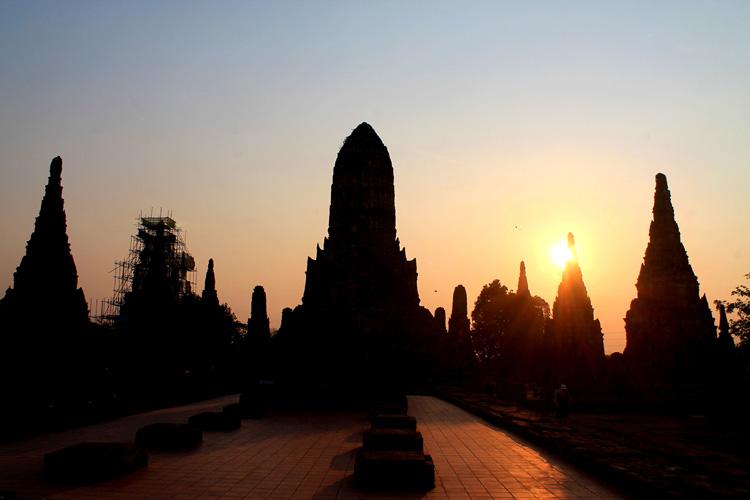 Cycling to the ruins in Ayutthaya, Thailand -- Wat Whaiwattanaram sunset