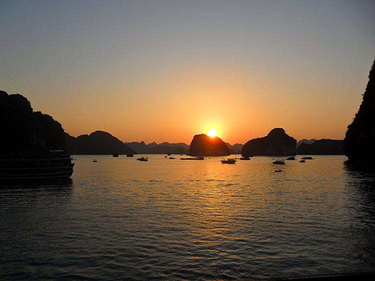 Sunset on the cheap Ha Long Bay cruise, Vietnam