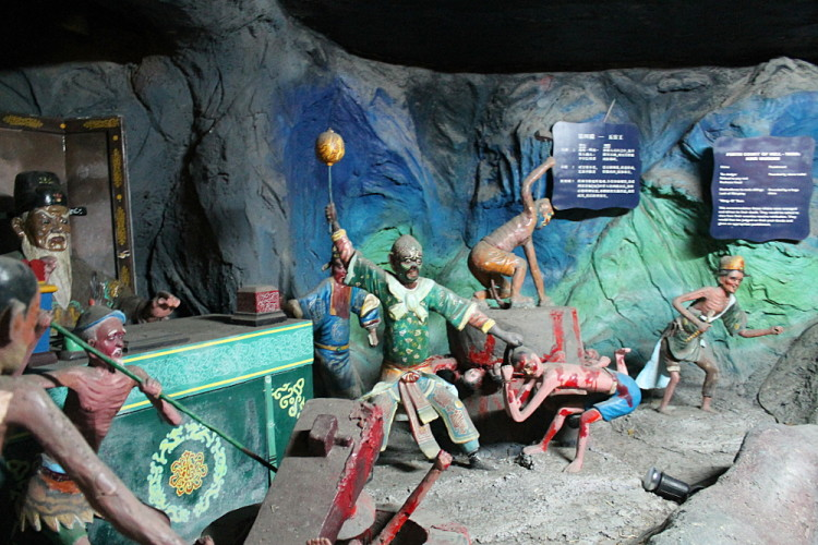 A brutal scene in the 10 Courts of Hell at Haw Par Villa, Singapore