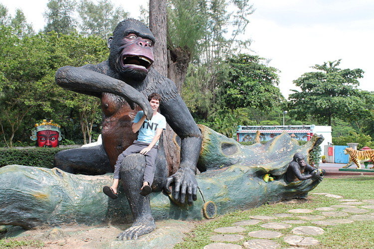 Posing with a gorilla at Haw Par Villa, Singapore
