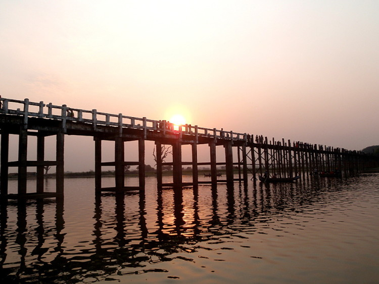 The longest teak bridge in the world at sunset in Amarapura, one of the old capitals in Mandalay, Myanmar