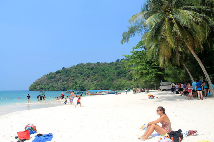 A crowded beach on the island hopping tour in Langkawi, Malaysia