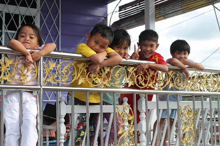 kids in Kampong Ayer, a water village in Brunei