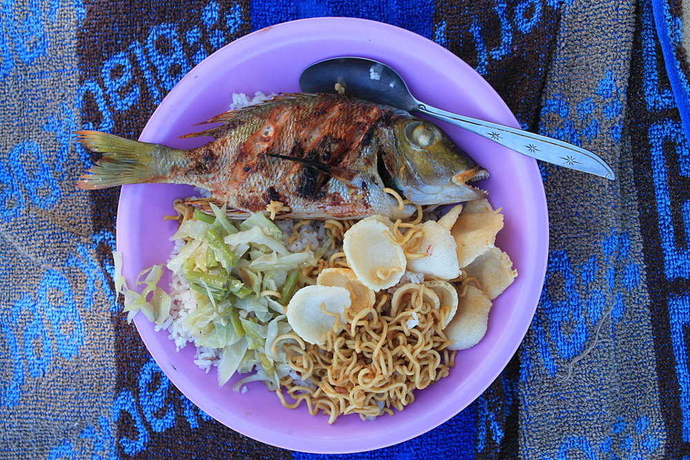 Seafood lunch on the 17 Islands boat tour in Riung, Flores, Indonesia