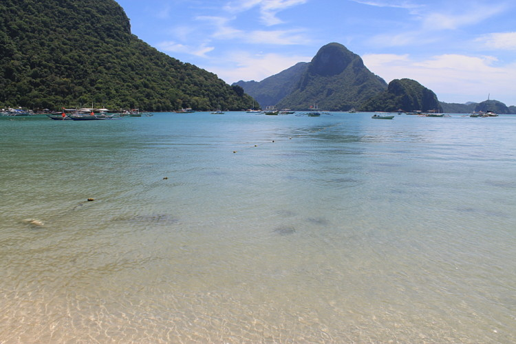 The clear water of the beach in El Nido town, one of the beaches of El Nido, Palawan, The Philippines