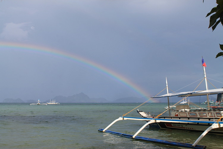 A rainbow at Corong Corong beach, one of the beaches of El Nido, Palawan, The Philippines