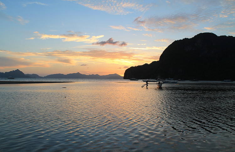 Sunset on Corong Corong beach, one of the beaches of El Nido, Palawan, The Philippines