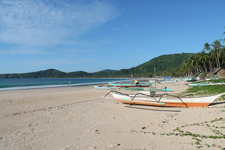 Boats on Nacpan Beach, one of the beaches of El Nido, Palawan, The Philippines