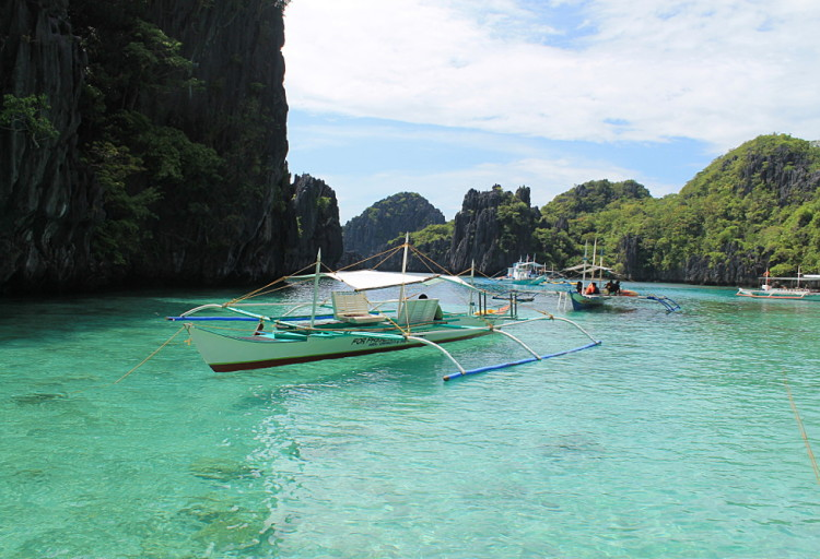 Snorkeling in a small lagoon in the Bacuit archipelago, El Nido, Palawan, The Philippines