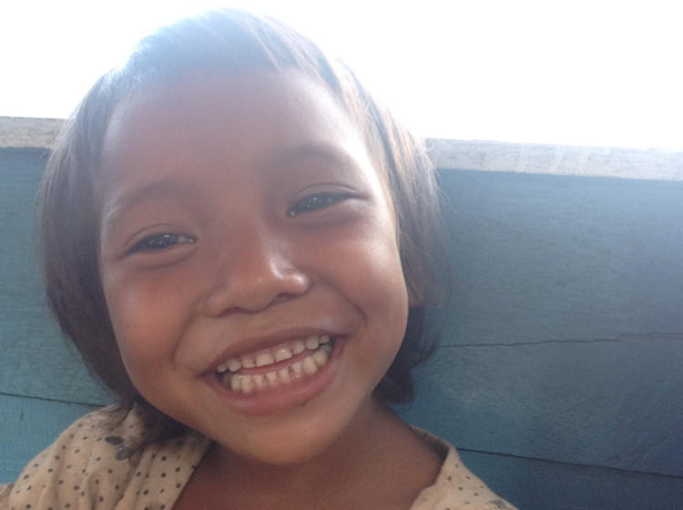 A Lao girl on the boat from Nong Khiaw to Muang Ngoi