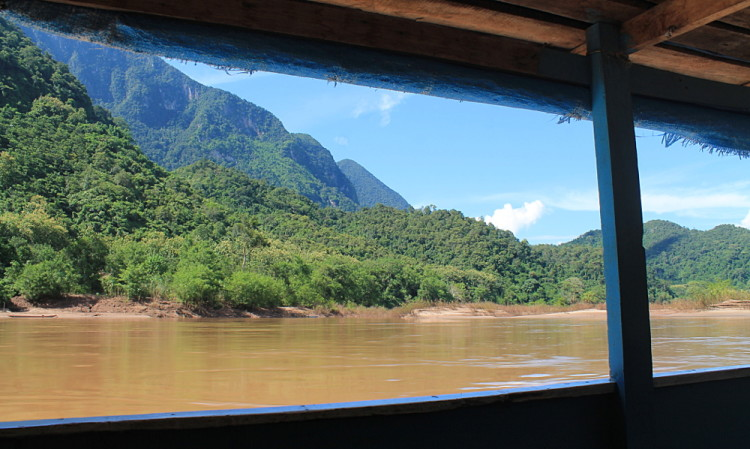 The scene from a window on the boat trip from Nong Khiaw to Muang Ngoi, Laos