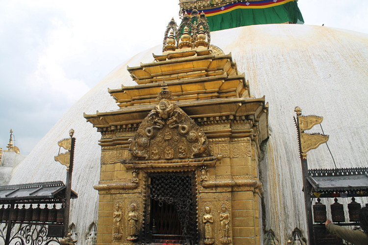 A gold and white temple at the monkey temple in Kathmandu, Nepal