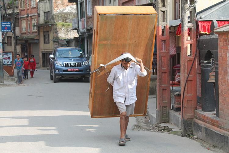 A man carrying furniture through the streets of Kathmandu, Nepal