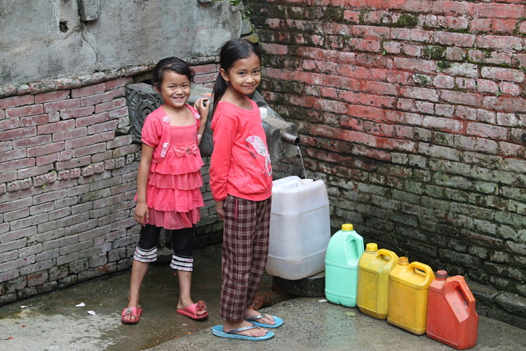 Kids filling up water on the streets of Kathmandu, Nepal