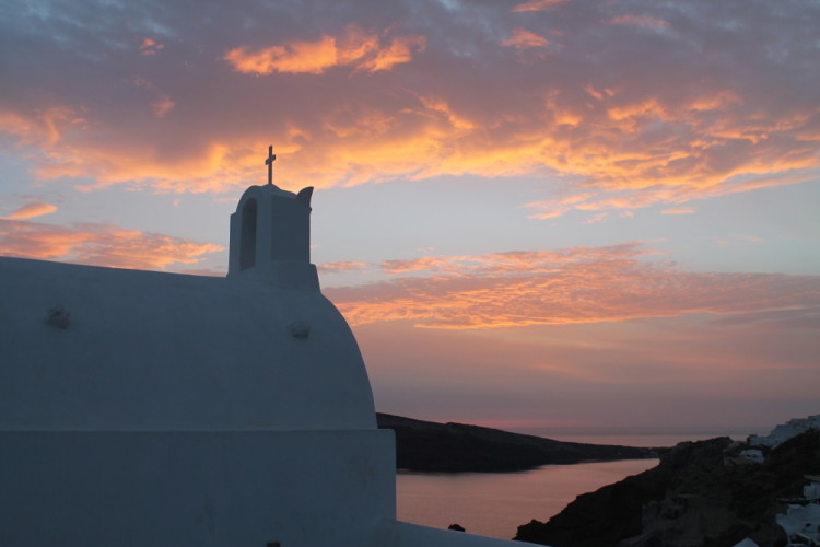 Sunset in Oia, after walking from Fira to Oia, Santorini, Greece
