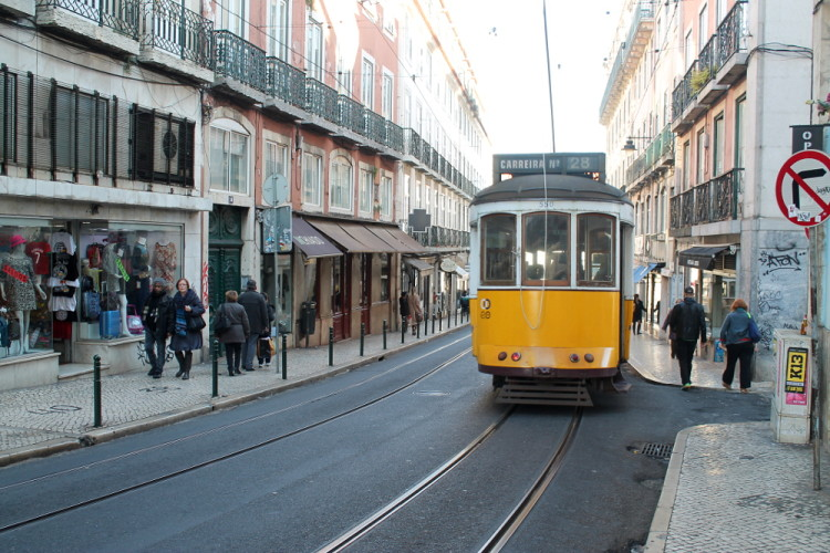 Tram 28 takes you up some of the hills in Lisbon, and around the historical areas
