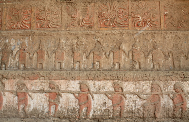 Desert ruins in northern Peru: Colourful carvings Huaca de la Luna