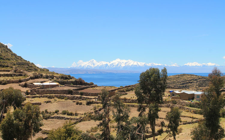 Hiking Isla del Sol, Bolivia: Farmland, snow mountains and Lake Titicaca