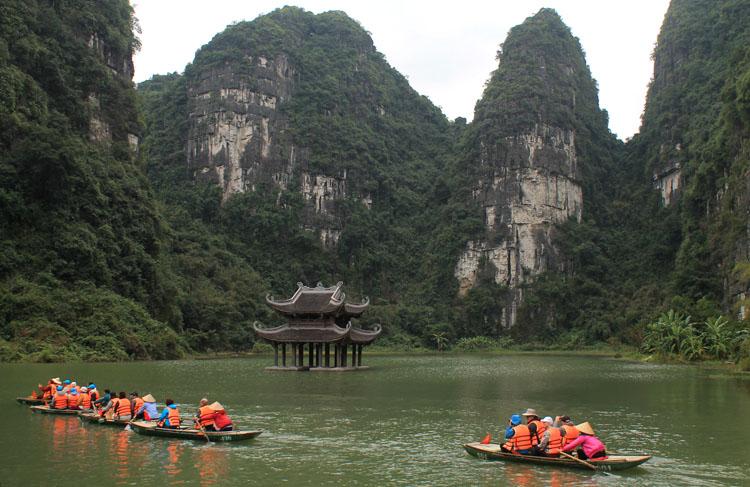 Boats touring the Trang An Gottos near Ninh Binh, Vietnam