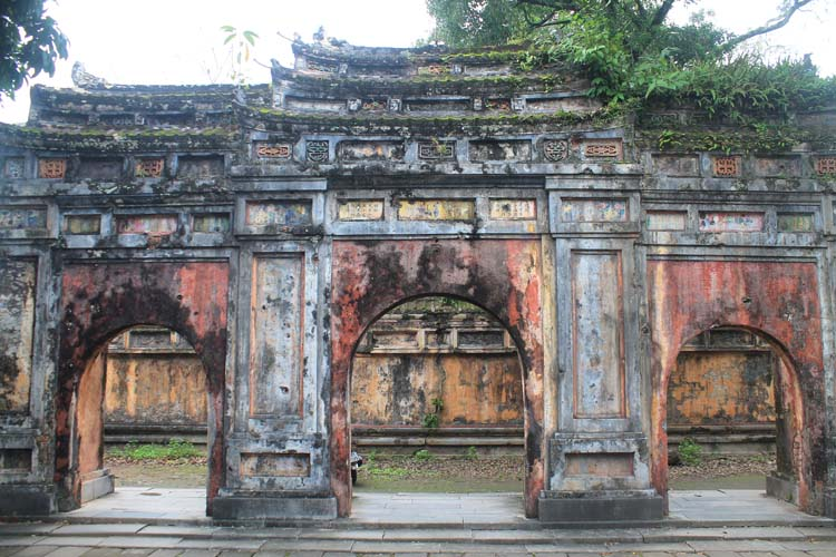 A day in Hue, Vietnam -- A gate covered in bullet holes in the Imperial Citadel