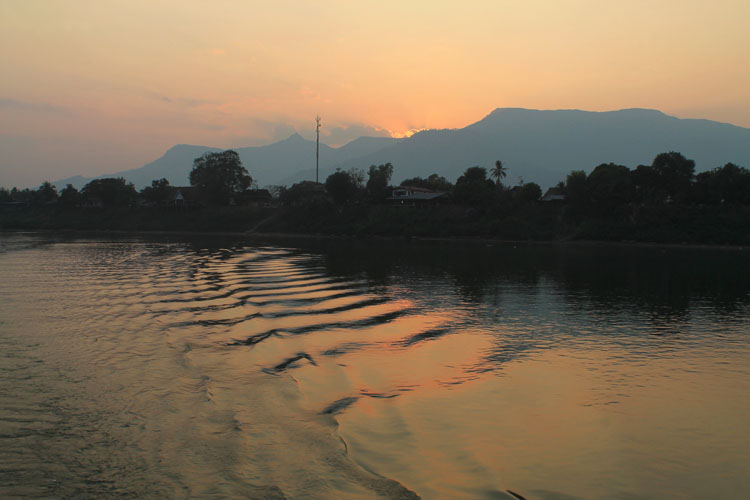 A 3 day Mekong River cruise in southern Laos -- sunset over the mountains