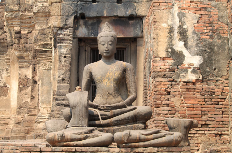 Exploring the ruins in Lopburi, Thailand -- The Monkey Temple's seated Buddha