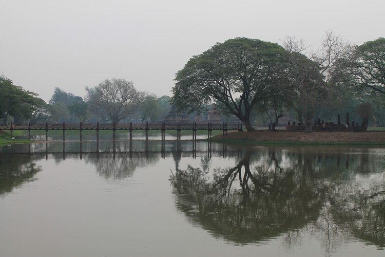Cycling between Ancient Ruins in Sukhothai, Thailand -- trees and ponds