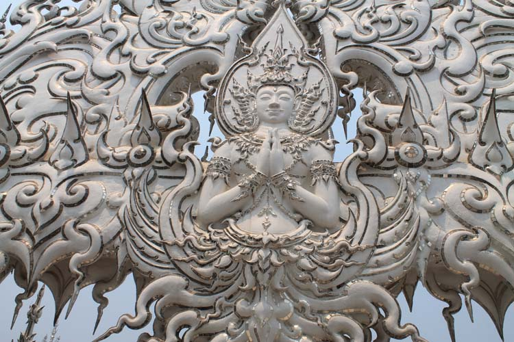 Close up of Wat Rong Khun, the white temple in Chiang Rai, Thailand