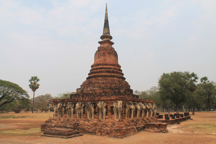 Cycling between Ancient Ruins in Sukhothai, Thailand -- Elephant temple