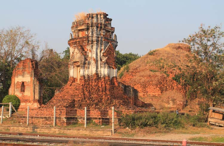 Exploring the ruins in Lopburi, Thailand -- a temple by the train tracks