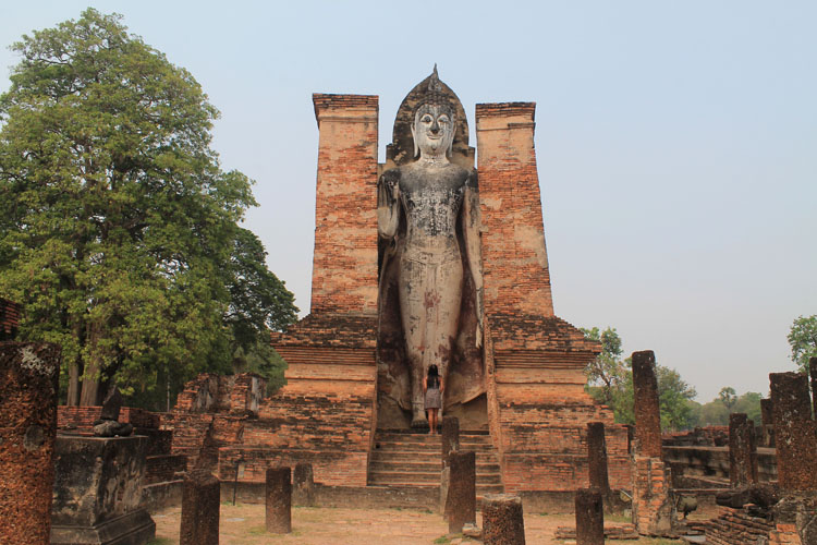 Cycling between Ancient Ruins in Sukhothai, Thailand -- Standing Buddha statue