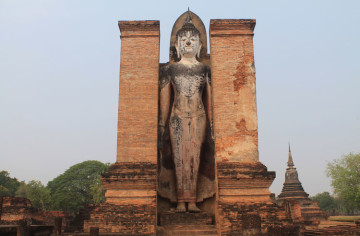 Cycling between Ancient Ruins in Sukhothai, Thailand