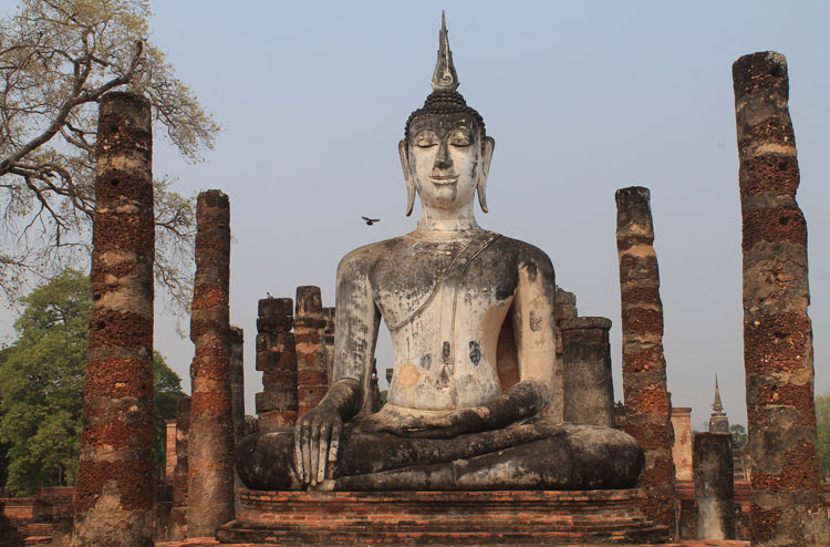 Cycling between Ancient Ruins in Sukhothai, Thailand -- Wat Mahathat seated Buddha