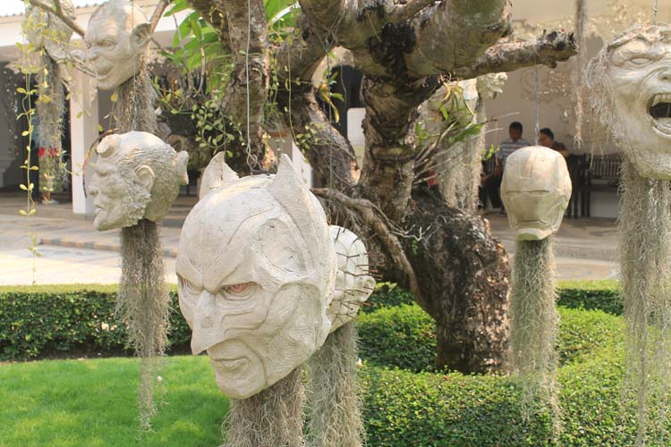 Heads in trees at Wat Rong Khun, the white temple in Chiang Rai, Thailand