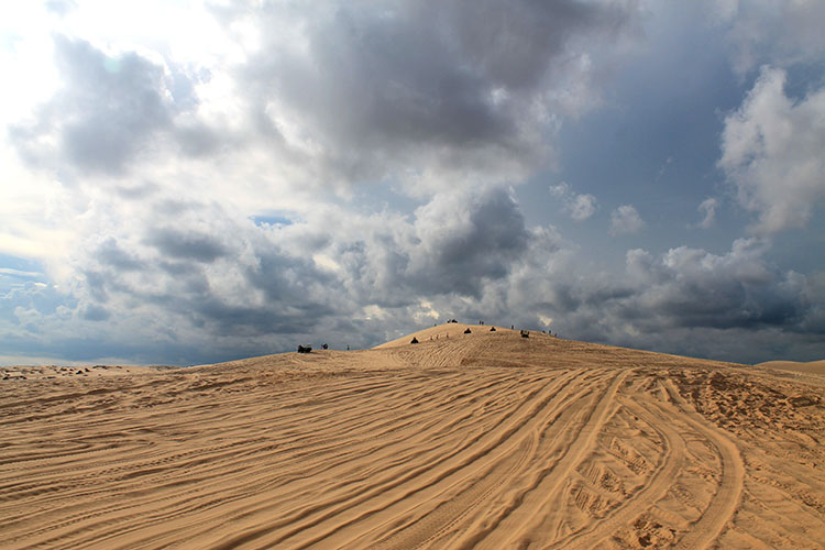 The Mui Ne sand dunes tour, Vietnam: ATV tracks in the White Dunes