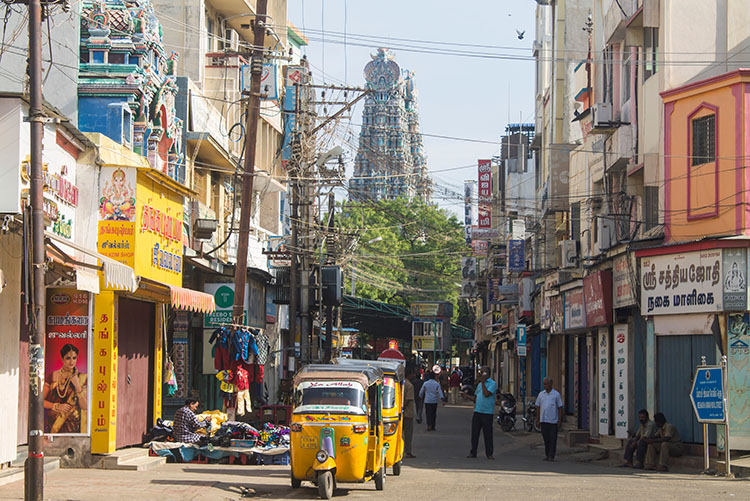 The busy streets of Madurai with Meenakshi Temple in the background